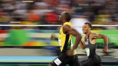 Usain Bolt and Andre De Grasse running in the Olympics
